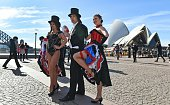 French cancan dancers kick up their heels near the Sydney Opera House as Australia celebrates France's Bastille Day in Sydney on July 14 2016...