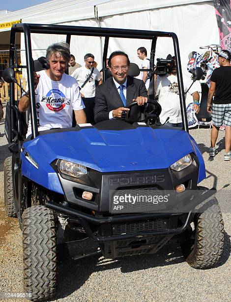 French candidate for the Socialist Party nomination for France's next year's presidential vote Francois Hollande rides a Polaris electric ranger on...