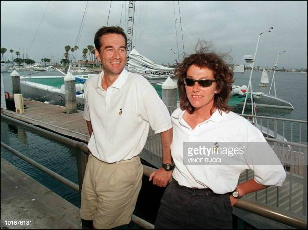 French captain Bruno Peyron and crewmember Florence Arthaud wait near the catamaran 'Explorer' in Long Beach prior to the start of the multihull...