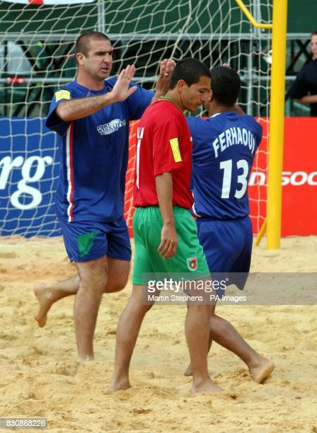 French captain Eric Cantona celebrates with teamate Kader Ferhaoui after scoring against Portugal during the Kronenbourg Cup beach football...