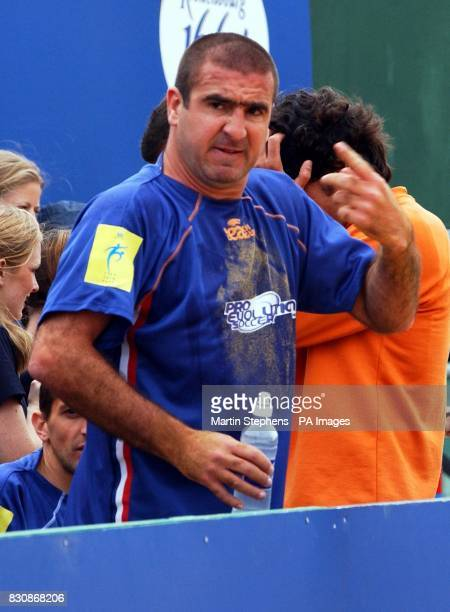 French captain Eric Cantona gestures as he watches his team in action during the Kronenbourg Cup beach football tournament held on the beach in...