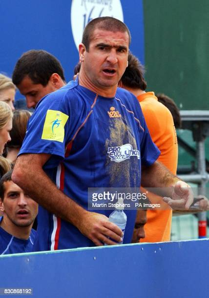 French captain Eric Cantona shouts instructions to his team during the Kronenbourg Cup beach football tournament held on the beach in Brigthon