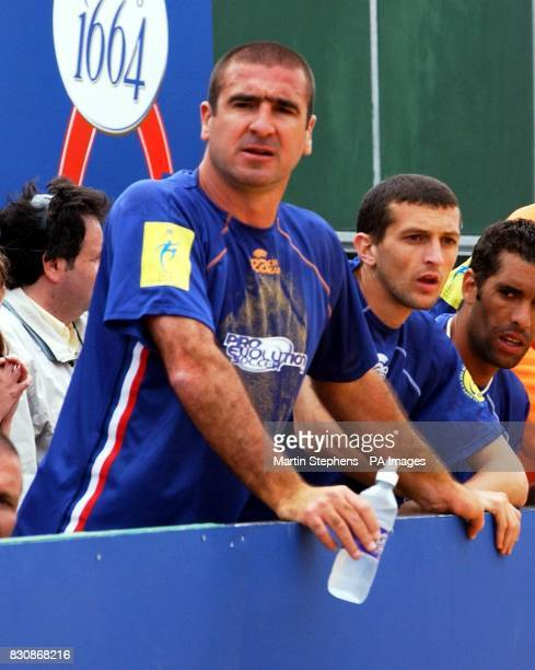 French captain Eric Cantona watches his team in action during the Kronenbourg Cup beach football tournament held on the beach in Brigthon