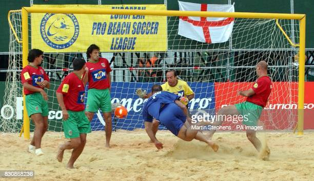 French captain former Manchester United star Eric Cantona scores with a diving header in a match against Portugal during the Kronenbourg Cup beach...