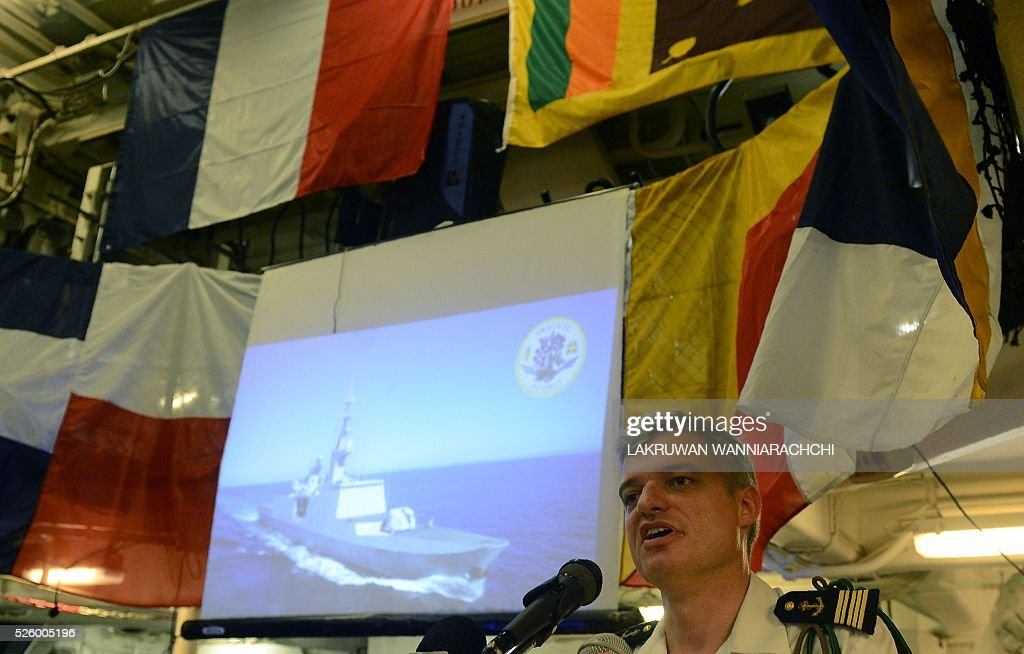 French Captain Laurent Machard de Gramont talks during a press conference aboard French naval ship Aconit at Sri Lanka's Colombo harbour on April 29, 2016. The French navy vessel is on a week-long visit to Sri Lankas main sea port of Colombo. / AFP / LAKRUWAN