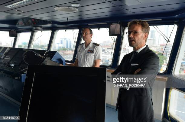 French captain Stanislas de Chargeres and French ambassador to Sri Lanka and the Maldives JeanMarin Schuh address media from the bridge of French...