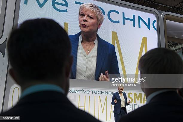 French carmaker Citroen CEO Linda Jackson has her image displayed on a giant screen as she presents the 'Cactus' concept car during a press day of...
