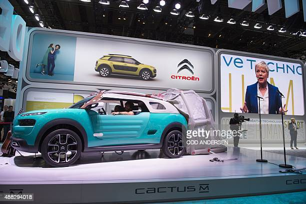 French carmaker Citroen CEO Linda Jackson presents the 'Cactus' concept car during a press day of the 66th IAA auto show in Frankfurt am Main western...
