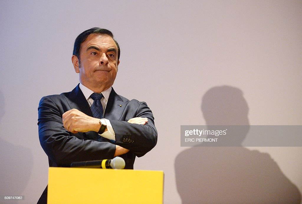French carmaker Renault CEO Carlos Ghosn listens during the financial annual results presentation at the group headquarters in Boulogne-Billancourt, near Paris, on February 12, 2016 . / AFP / ERIC PIERMONT
