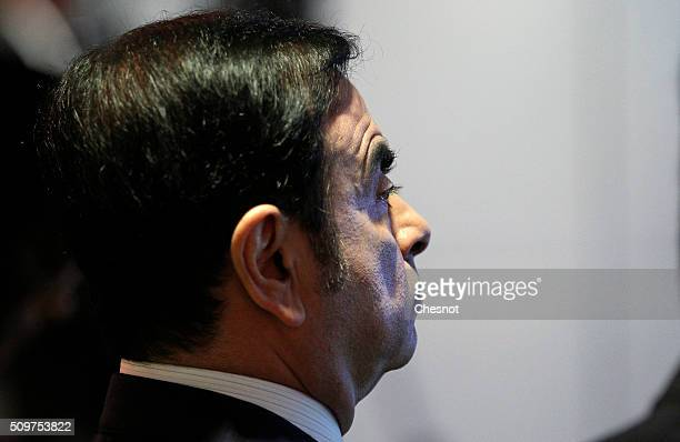 French carmaker Renault CEO Carlos Ghosn talks to media during the financial annual results presentation at the group headquarters on February 12...