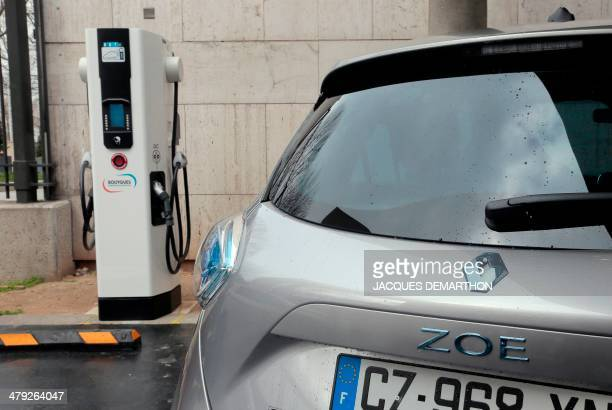 A French carmaker Renault's electric car Zoe is parked on March 17 2014 in Paris at the charging station for electric vehicles dedicated to public...