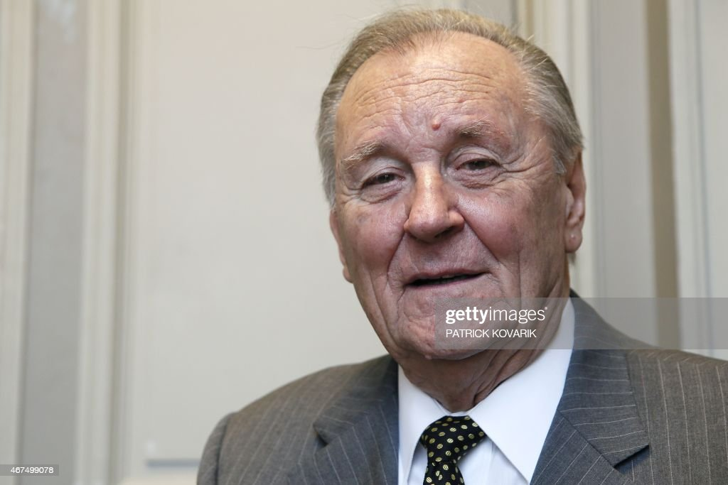 French cartoon artist Albert Uderzo poses after a press conference at the Monnaie de Paris in Paris on March 25, 2015 during which a new series of twelve coins illustrated with Asterix designs entitled 'Asterix and the values of the Republic' was presented.