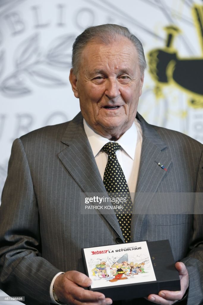 French cartoon artist <a gi-track='captionPersonalityLinkClicked' href=/galleries/search?phrase=Albert+Uderzo&family=editorial&specificpeople=2121085 ng-click='$event.stopPropagation()'>Albert Uderzo</a> poses with a new series of twelve coins illustrated with Asterix designs entitled 'Asterix and the values of the Republic' during a press conference at the Monnaie de Paris in Paris on March 25, 2015. AFP PHOTO / PATRICK KOVARIK