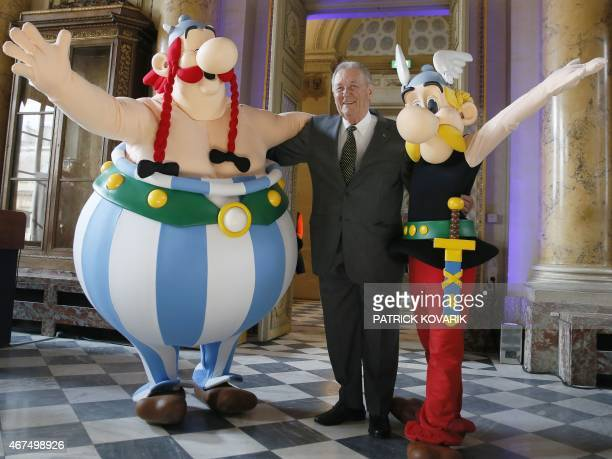 French cartoon artist Albert Uderzo poses with people dressed as Asterix and Obelix during a press conference at the Monnaie de Paris where a new...