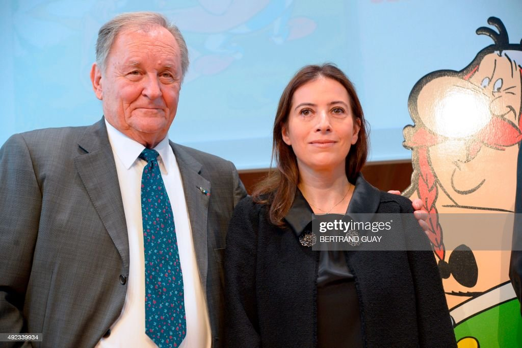 French cartoonist and author Albert Uderzo and the daughter of late French author and cartoonist Rene Goscinny Anne Goscinny pose beside a cardboard...