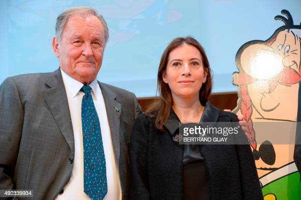 French cartoonist and author Albert Uderzo and the daughter of late French author and cartoonist Rene Goscinny Anne Goscinny pose beside a cardboard...