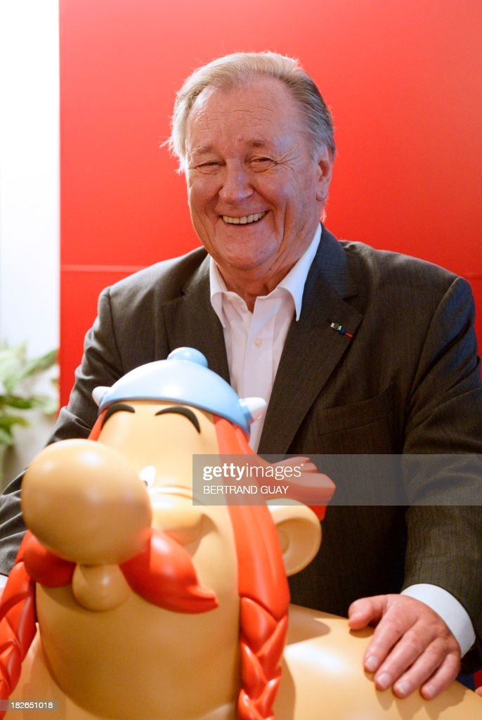 French cartoonist and author Albert Uderzo, coauthor with French Rene Goscinny, of the popular comic book Asterix, poses after a press conference in Paris on October 2, 2013 for the release of the album 'Asterix chez les Pictes' (Asterix and the Picts) relating the adventures of Asterix (Obelix, the second major character of the series, foreground), a diminutive moustachioed warrior battling the Roman occupation of his native Gaul, or ancient France. it is the first time Uderzo does not participate in the creation of the album. GUAY