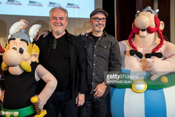 French cartoonist Didier Conrad and French writer and designer JeanYves Ferri pose with effigies of comic book characters Asterix and Obelix during a...