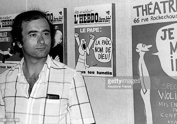 French Cartoonist Georges Wolinski in front of his drawings including the ones from 'L'Hebdo harakiri' at the exhibition 'July 26 1969/70' for the...