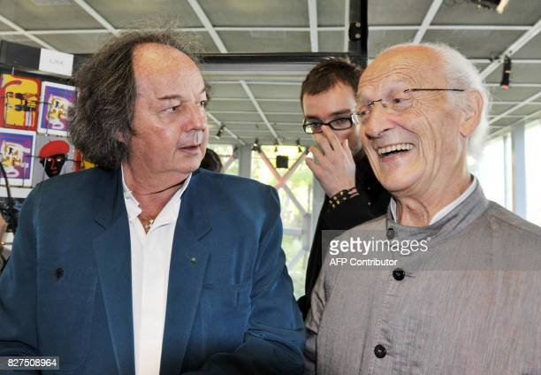 French cartoonist Jean Giraud aka 'Moebius' talks with French journalist and writer Gonzague Saint Bris on October 10 2010 at the fondation Cartier...
