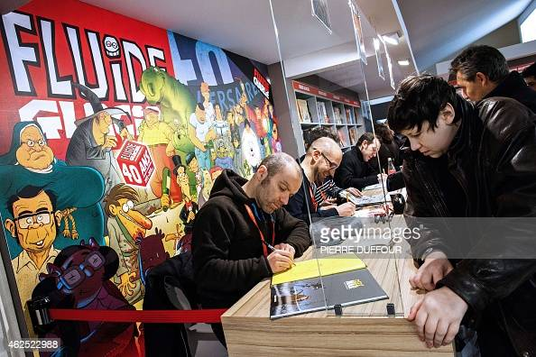 French cartoonist Mo/CDM signs a copy of his book 'Geek War' during the 42nd Angouleme International Comics Festival on Friday 30 2015 in Angouleme...