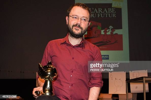 French cartoonist Riad Sattouf poses with his 'Fauve d'Or' award of the best comic book after receiving it for his comic book 'L'Arabe du futur' on...