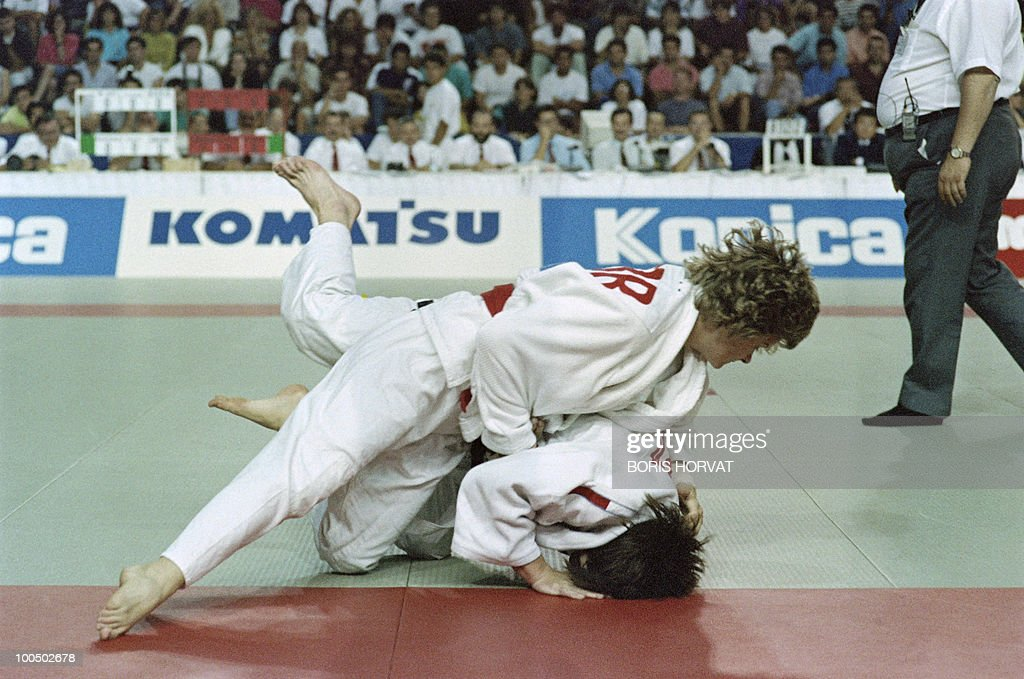 French Catherine Arnaud (below) and British Nicola Fairbrother fight during the World championships final in judo, on July 28, 1991, in Barcelona.