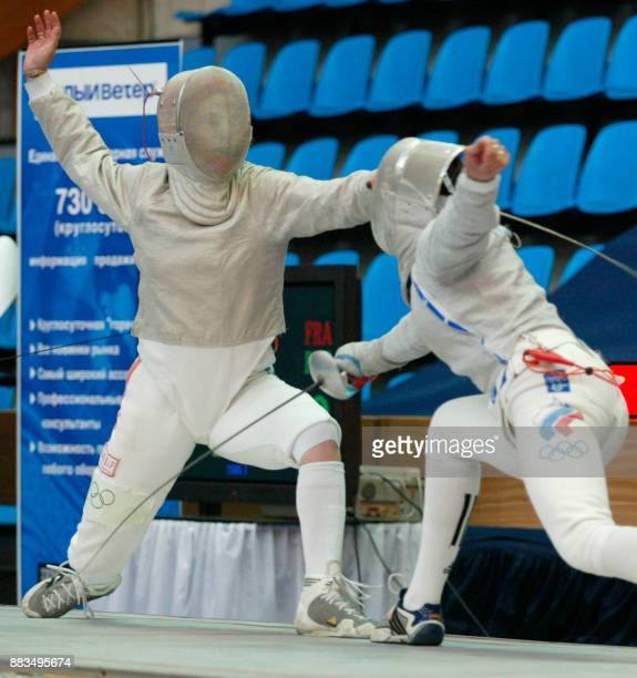 French Cecile Argiolas fights with Russian Yelena Netchayeva during the final fight of Fencing Euro Championship in Moscow 08 July 2002 Argiolas won...