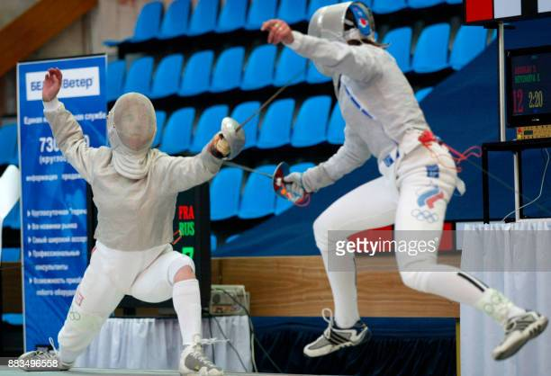 French Cecile Argiolas vies with Russian Yelena Netchayeva during the final of the Fencing Euro Championship in Moscow 03 July 2002 Argiolas won the...