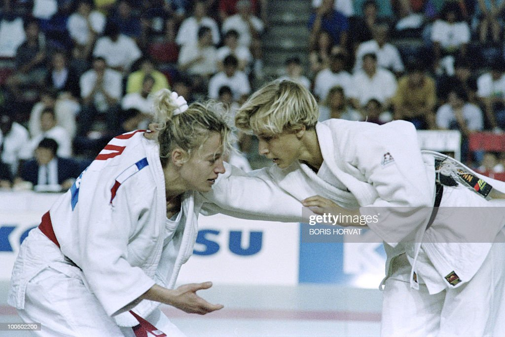 French Cecile Nowak (L) and Austrian Michaela Bornemann fight during the World championships final in judo, on July 28, 1991, in Barcelona.