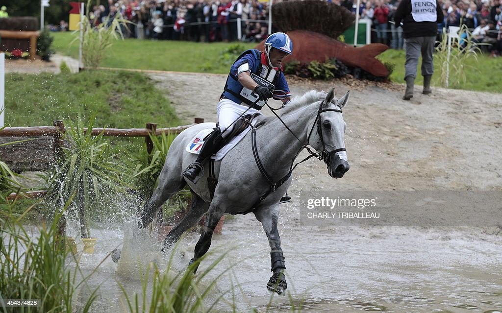 French Cedric Lyard rides Cadeau du Roi on August 30 2014 during the timetable crosscountry test of the 2014 FEI World Equestrian Games at the Haras...
