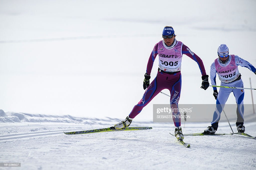 French Celia Bourgeois (2nd R) vies with Estonian Tatjana Mannima during the Nordic Transjurassienne skiing race on February 10, 2013 in Lamoura, eastern France. Bourgeois won the race in the women category (54 Km).