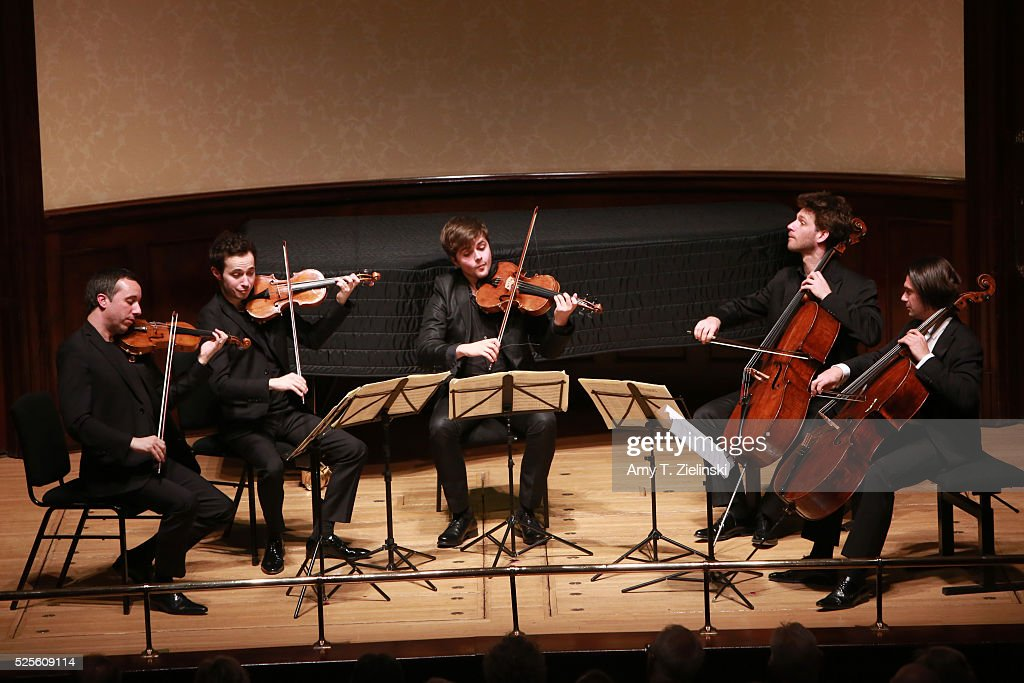 French cellist Gautier Capucon (R) joins Quatuor Ebene with (L-R) Pierre Colombet on violin, Gabriel Le Magadure on violin, Adrien Boisseau on viola and Raphael Merlin on cello for a performance of Franz Schubert's String Quintet in C major D956 at Wigmore Hall on April 28, 2016 in London, England.