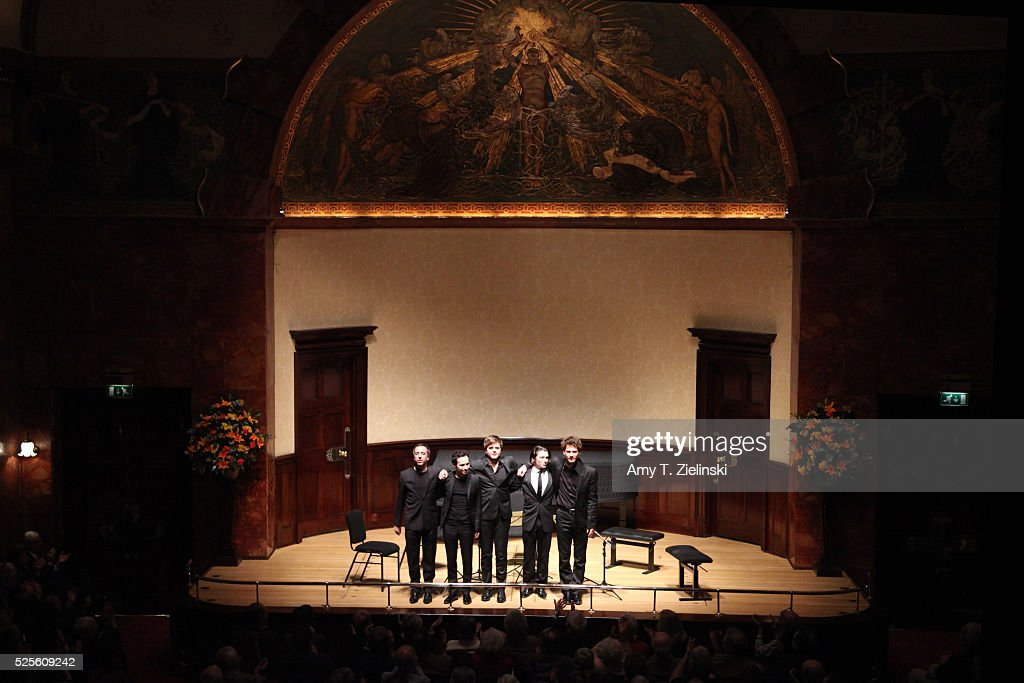 French cellist Gautier Capucon (R) with Quatuor Ebene with (L-R) Pierre Colombet on violin, Gabriel Le Magadure on violin, Adrien Boisseau on viola and Raphael Merlin on cello receive the audience after a performance of Franz Schubert's String Quintet in C major D956 at Wigmore Hall on April 28, 2016 in London, England.