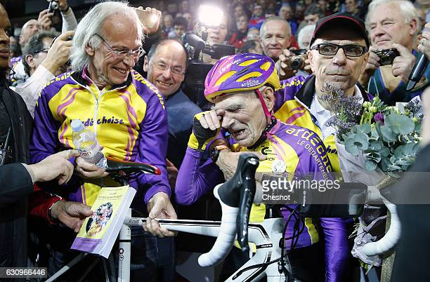 French centenarian cyclist Robert Marchand aged 105 reacts after cycling in a bid to beat his record for distance cycled in one hour in the over105...