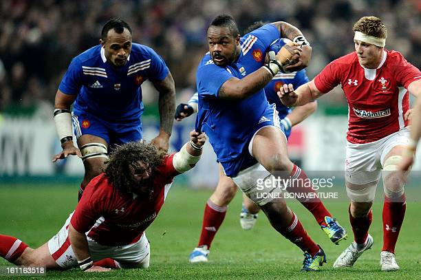 French center Mathieu Bastareaud vies with Wales' prop Adam Jones during the Six Nations Rugby Union match between France and Wales at the Stade de...