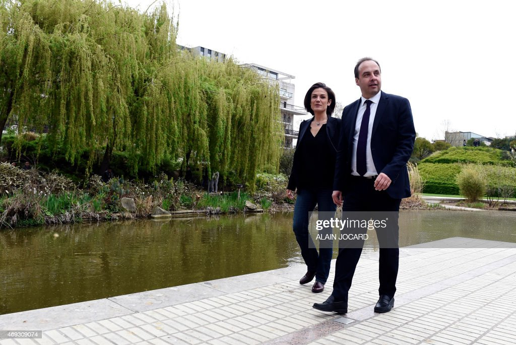 French center-right UDI party president <a gi-track='captionPersonalityLinkClicked' href=/galleries/search?phrase=Jean-Christophe+Lagarde&family=editorial&specificpeople=7499467 ng-click='$event.stopPropagation()'>Jean-Christophe Lagarde</a> (R) and French Senator <a gi-track='captionPersonalityLinkClicked' href=/galleries/search?phrase=Chantal+Jouanno&family=editorial&specificpeople=5673060 ng-click='$event.stopPropagation()'>Chantal Jouanno</a>, UDI candidate for the December 2015 French regional elections in the Ile-de-France region, walk in a park in Paris on April 11, 2015, during the UDI national council.