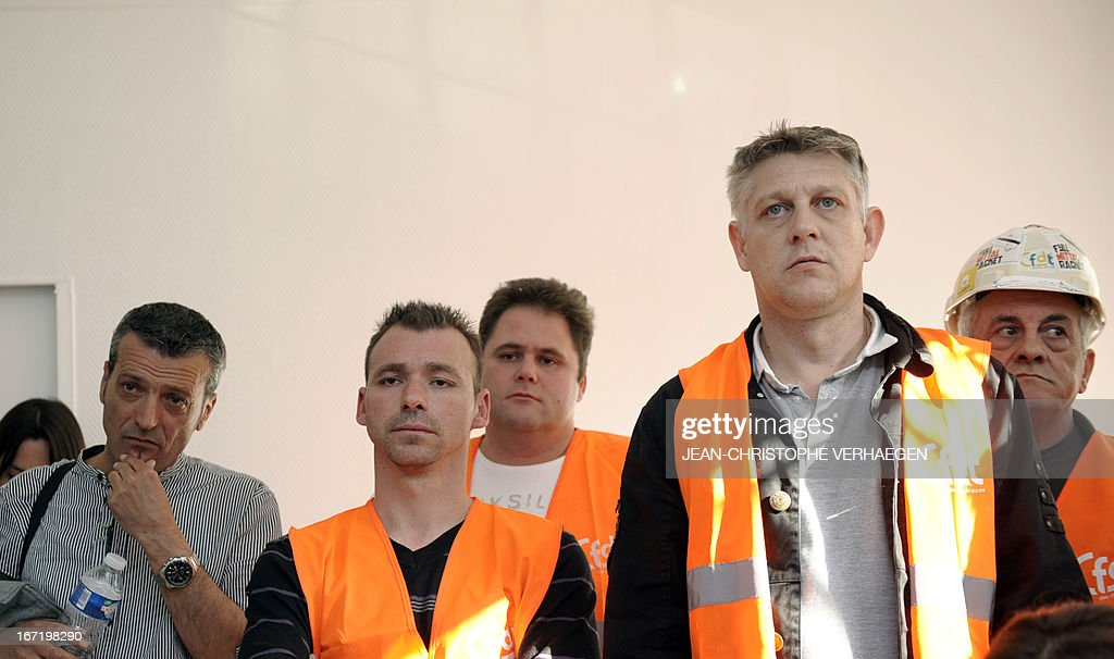 French CFDT union representative of the Steel giant group ArcelorMittal's plant in Florange, Edouard Martin (L) and other unionists listen to the CEO of ArcelorMittal Atlantique(western France) and Lorraine (eatern France) and French sub-prefect of Moselle, eastern France, in charge of the implementation of an agreement with ArcelorMittal (not in the picture) after participating in a monitoring committee on April 22, 2013 in Metz. ArcelorMittal pledged last week to suspend closures and job cuts in Europe pending the launch of a pan-Europe plan in June to save the struggling steel industry. The steel group's recent decisions to shutter plants in Belgium, Luxembourg and France triggered violent protests. VERHAEGEN