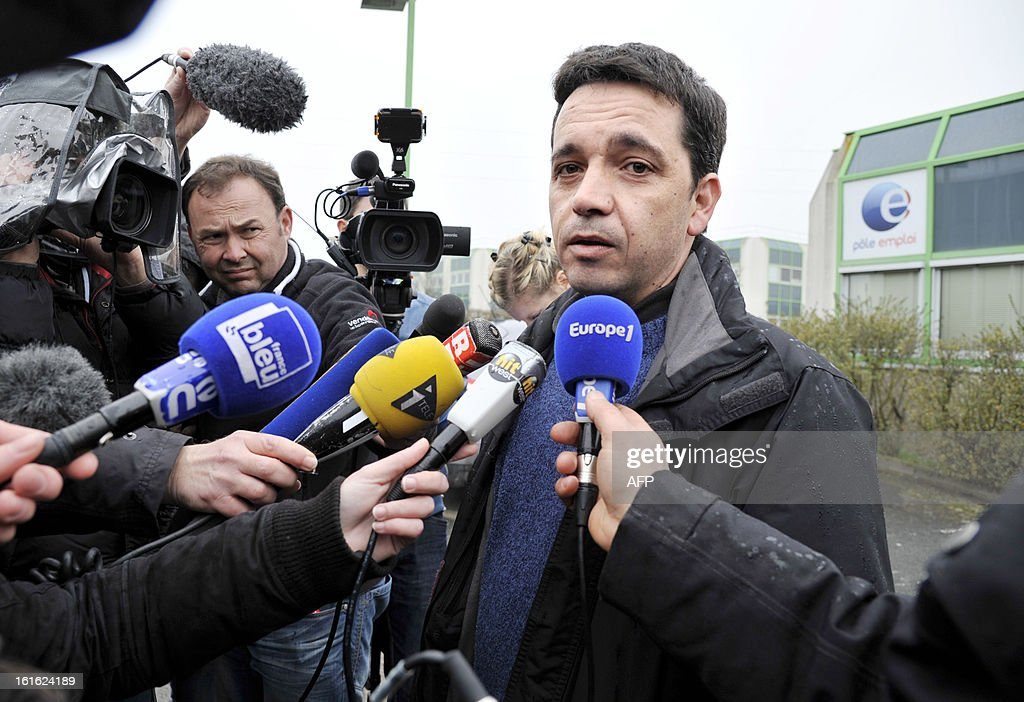French CGT union representative Julien Chaillou answers journalists in front of a French state employment agency, Pole Emploi, in Nantes, western France on February 13, 2013 following the self immolation of an unemployed Frenchman. The man had sent messages to journalists warning he would set himself alight this week after being declared ineligible for unemployment benefits. The number of unemployed has risen steadily in France for the past 20 months, and could soon reach the record high set in January 1997 of 3.2 million. AFP PHOTO / ALAIN LEMASSON