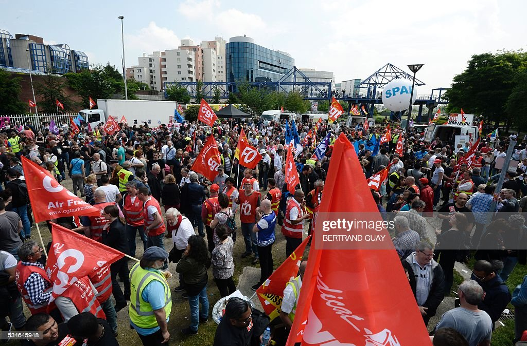 French CGT union's members holding union's flags gather outside the court of Bobigny, northern Paris on May 27, 2016 during the trial of 15 French CGT union's members judged for the episode of the torn shirt, in full showdown initiated by the union with the government on labor law. the court of Bobigny, northern Paris on May 27, 2016 during the trial of French CGT union's members judged for the episode of the torn shirt, in full showdown initiated by the union with the government on labor law. On October 5, 2015 under the cries of naked, naked and resignation , the Air France human resources director found himself shirtless, tattered shirt during a protest after the announcement of a restructuring of the airline threatening nearly 3,000 jobs.
