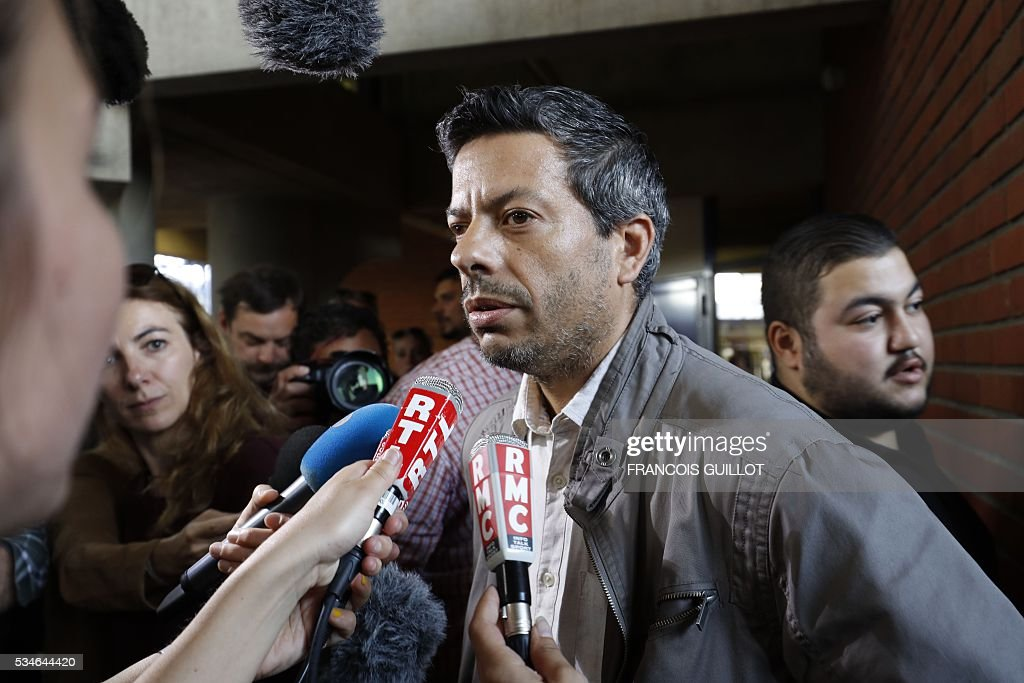 French CGT union's representative Miguel Fortea speaks at the court of Bobigny, northern Paris on May 27, 2016 during the trial of 15 French CGT union's members judged for the episode of the torn shirt, in full showdown initiated by the union with the government on labor law. On October 5, 2015 under the cries of naked, naked and resignation , the Air France human resources director found himself shirtless, tattered shirt during a protest after the announcement of a restructuring of the airline threatening nearly 3,000 jobs.