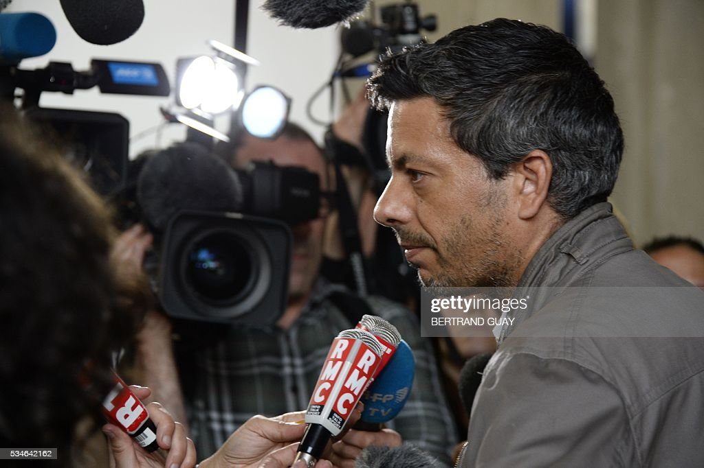 French CGT union's representative Miguel Fortea speaks to journalists at the court of Bobigny, northern Paris on May 27, 2016 during the trial of 15 French CGT union's members judged for the episode of the torn shirt, in full showdown initiated by the union with the government on labor law. On October 5, 2015 under the cries of naked, naked and resignation , the Air France human resources director found himself shirtless, tattered shirt during a protest after the announcement of a restructuring of the airline threatening nearly 3,000 jobs.