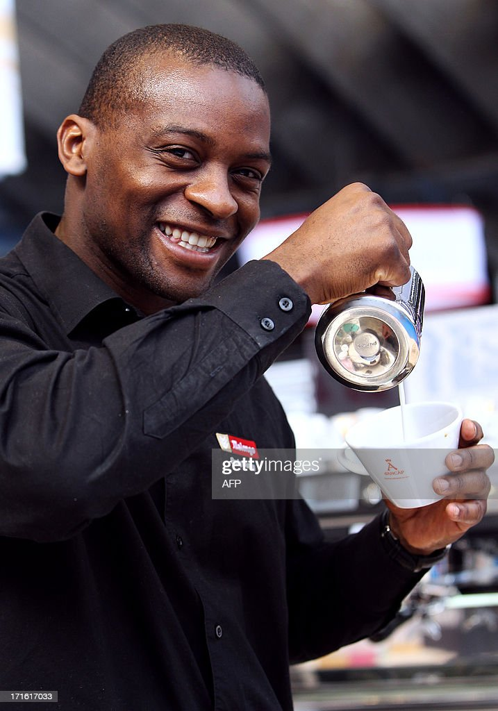 French champion of latte art Rudy Dupuy poses during the exhibition 'World of coffee', on June 27, 2013, in Nice, southeastern France.