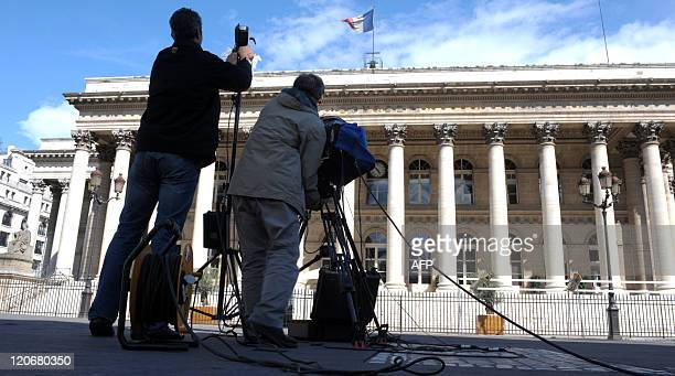 A French channel TV crew get work in front of the former Paris stock market exchange Bourse de Paris also known as Palais Brongniart on August 8 2011...