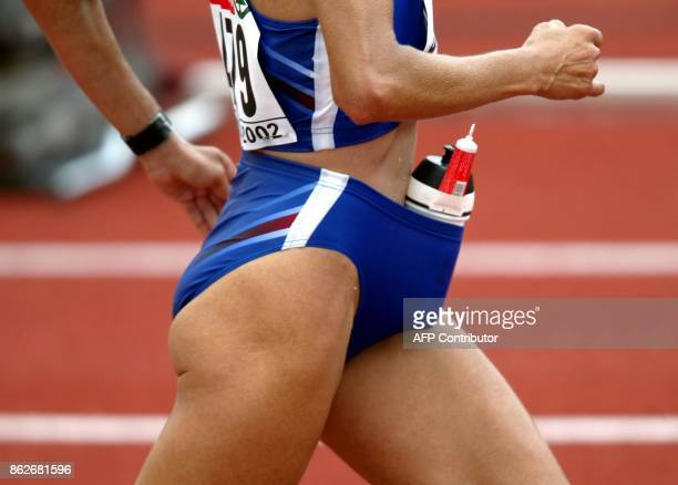 French Chantal Dallenbach carries something to drink and creme in her shorts during the women's marathon race at the European Athletics Championships...