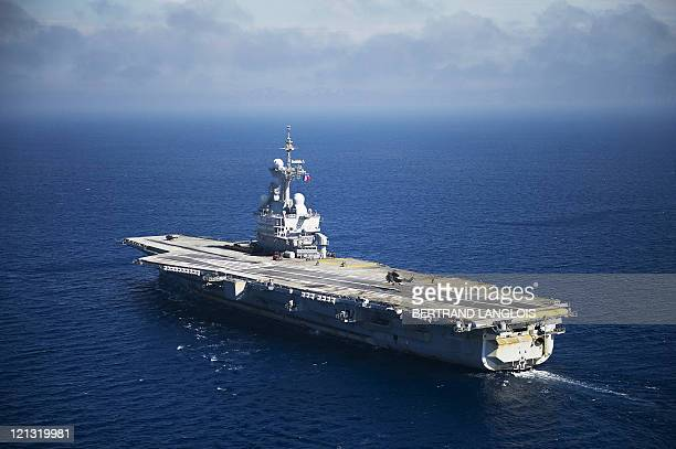 French Charles de Gaulle aircraft carrier sails to the harbour of the French southern port of Toulon on August 12 2011 The vessel France's only...