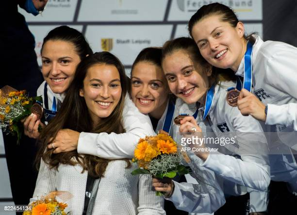 French Charlotte Lembach Sara Balzer Charlotte Lembach Manon Brunet Caroline Queroli and Cecilia Berder stand the podium after placed in the team...