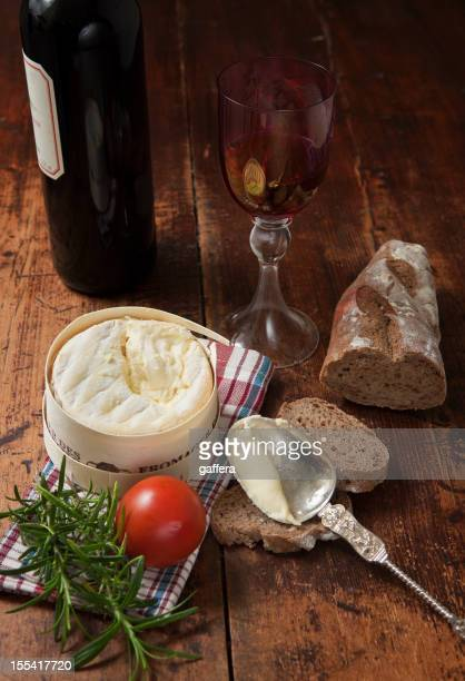 french cheese with bread and red wine