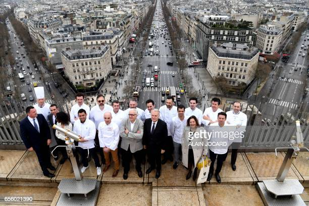 French chef Alain Ducasse and French Foreign Affairs minister JeanMarc Ayrault pose for a picture with French chefs on top of the the Arc de Triomphe...