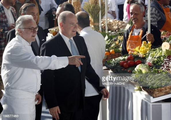 French chef Alain Ducasse and Prince's Albert II of Monaco visit a market as part of the festivities marking the 25th anniversary of Ducasse's...